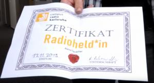 """Ausdruck mit Aufschrift """"Zertifikat Radioheld*in"""""""