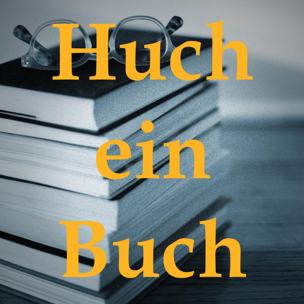 """Bücherstapel und Schriftzug """"Huch ein Buch"""""""