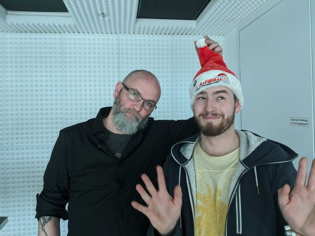 Chris und Matz mit Nikolausmütze